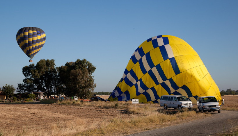 hot air balloon in flight and landing