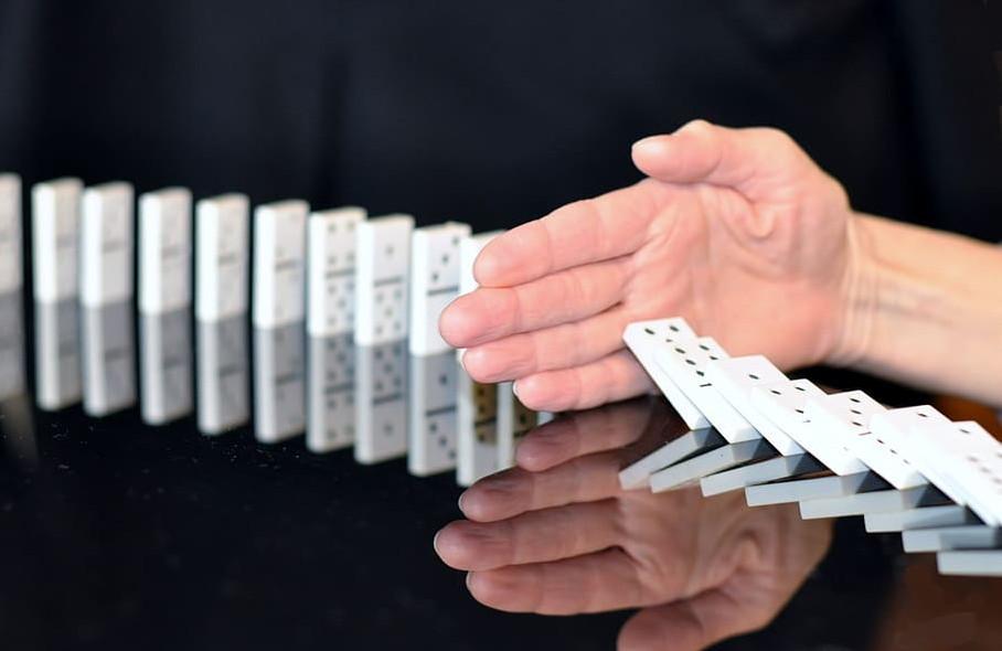 hand stops dominoes