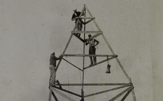 three guys on a tower